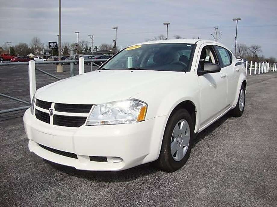 Suspects in a double homicide April 25 at Sweet Jimmie's restaurant in Oakland are believed to have been driving a white Dodge Avenger similar to this one. Photo: Oakland Police Department