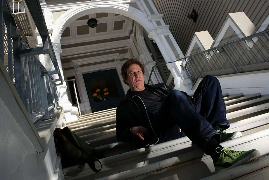 "Bruce Pavlow sitting in front of the halfway house for LGBT in the lower Haight  in San Francisco, Calif., on Monday, April 11, 2011.  He's now published a book of the photos called ""Survival House 1977."" Photo: Liz Hafalia, The Chronicle"