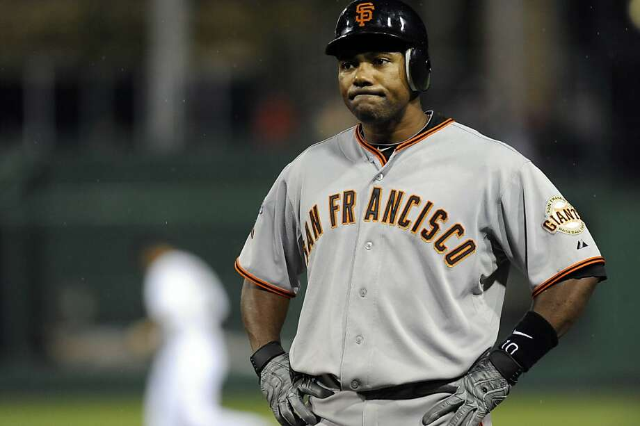 San Francisco Giants' Miguel Tejada reacts to hitting into a double play against the Pittsburgh Pirates during the ninth inning of a baseball game, Wednesday, April 27, 2011, in Pittsburgh. Pittsburgh won 2-0. Photo: Don Wright, AP