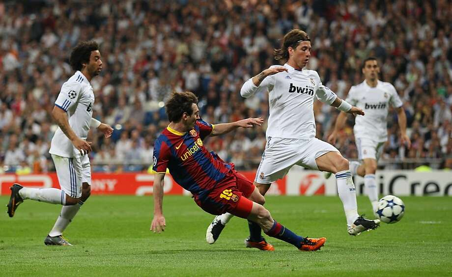 MADRID, SPAIN - APRIL 27:  Lionel Messi of Barcelona scores his second goal during the UEFA Champions League Semi Final first leg match between Real Madrid and Barcelona at Estadio Santiago Bernabeu on April 27, 2011 in Madrid, Spain. Photo: Alex Livesey, Getty Images