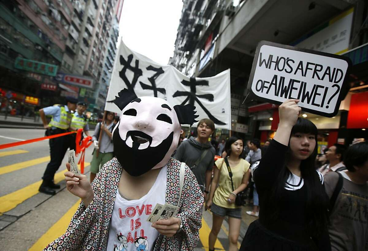 A pro-democracy protester wears a mask of detained Chinese artist Ai Weiwei during a march in Hong Kong Saturday, April 23, 2011 as they demand release of Ai. U.S. diplomats will discuss recent disappearances and detentions of Chinese dissidents during human rights talks in Beijing next week, the U.S. State Department said.