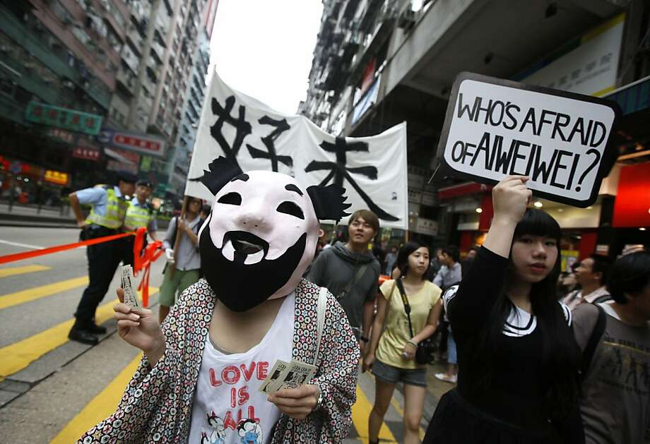 A pro-democracy protester wears a mask of detained Chinese artist Ai Weiwei during a march in Hong Kong Saturday, April 23, 2011 as they demand release of Ai. U.S. diplomats will discuss recent disappearances and detentions of Chinese dissidents during human rights talks in Beijing next week, the U.S. State Department said. Photo: Kin Cheung, Associated Press