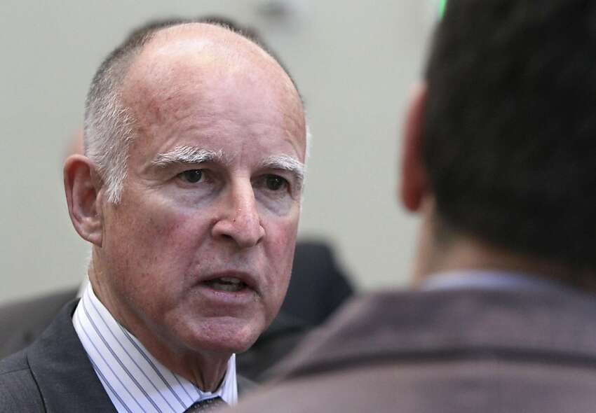 Gov. Jerry Brown talks with reporters after speaking at the Alliance of California Law Enforcement Legislative Day in Sacramento, Calif., Wednesday, April 6, 2011. Brown said he is still hoping to strike a deal with GOP lawmakers for a special election to ask Californians whether they want to extend increase to the sale, personal income and vehicle taxes to help close the rest of the state budget deficit.