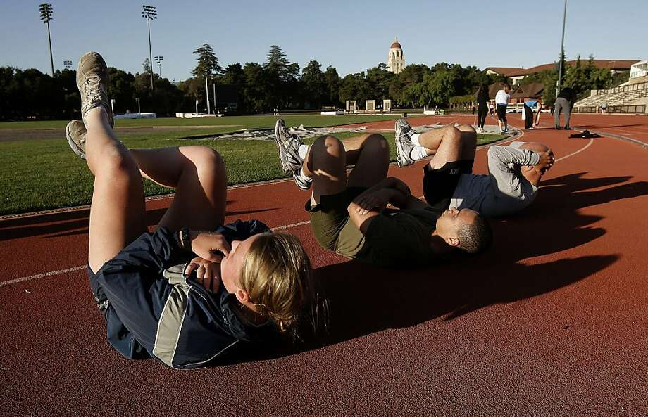 Aly Gleason, Ernest Haleck and Colonel Odie Sheffield, (a Stanford fellow) join members of the Stanford ROTC for a work out at Cobb Track Field in Palo Alto, Calif. on Wednesday April 27, 2011. Stanford's faculty senate will be voting on whether to bring back ROTC after a 40-year absence. Currently 14 ROTC students must travel to other Bay Area universities for their classes and drills. Photo: Michael Macor, The Chronicle