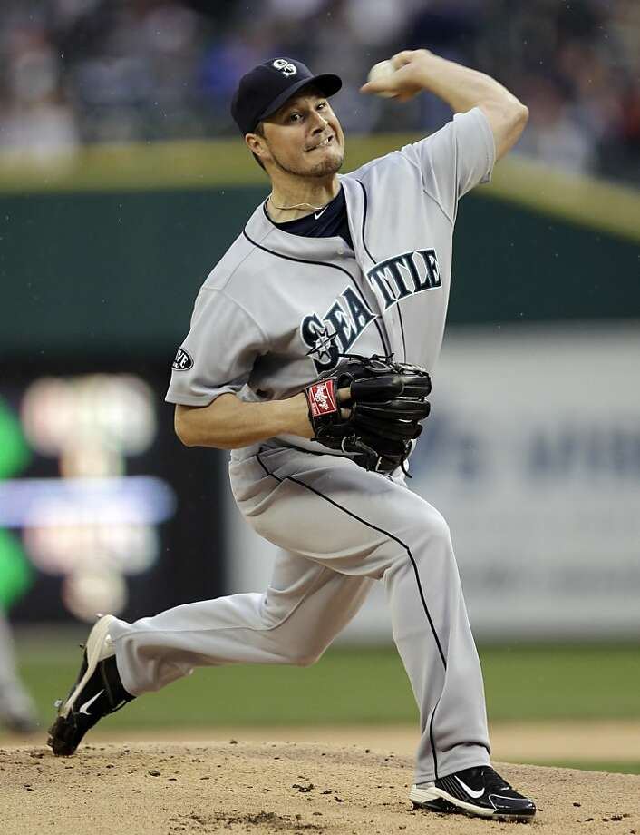 Seattle Mariners starting pitcher Erik Bedard (45) throws against the Detroit Tigers in the first inning of a baseball game in Detroit, Wednesday, April 27, 2011. Photo: Paul Sancya, AP