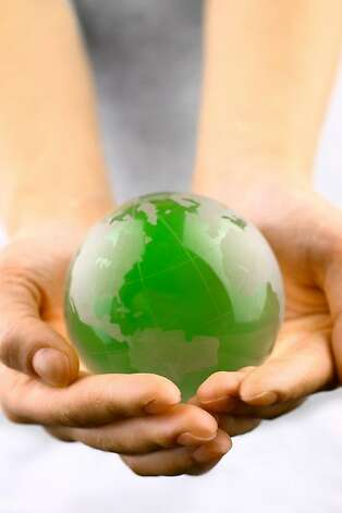 istock photo of hands holding a globe Photo: Istockphoto.com