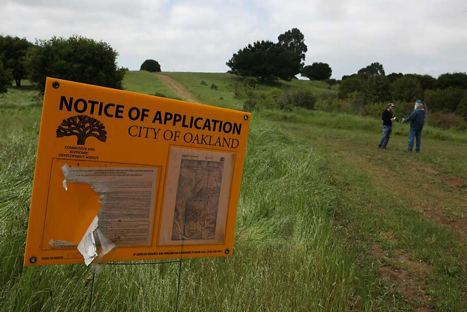 Notice of intent to expand the Oakland Zoo to the western highlands of Knowland Park in Oakland, Calif., on Tuesday,  April 19, 2011.  Where the people are standing are plans for a bear exhibit and more.  The Oakland Zoo wants to expand to build a 60-acre exhibit where environmentalists would like to keep as open space. Photo: Liz Hafalia, The Chronicle