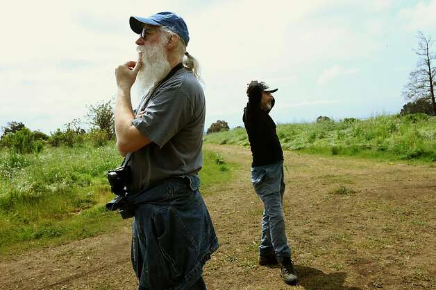 Tom DeBoni (left) and Terry Sayre (right) looking at the western highlands off one of the paths of Knowland Park in Oakland, Calif., on Tuesday,  April 19, 2011.  The Oakland Zoo wants to expand to build a 60-acre exhibit where environmentalists would like to keep as open space. Photo: Liz Hafalia, The Chronicle
