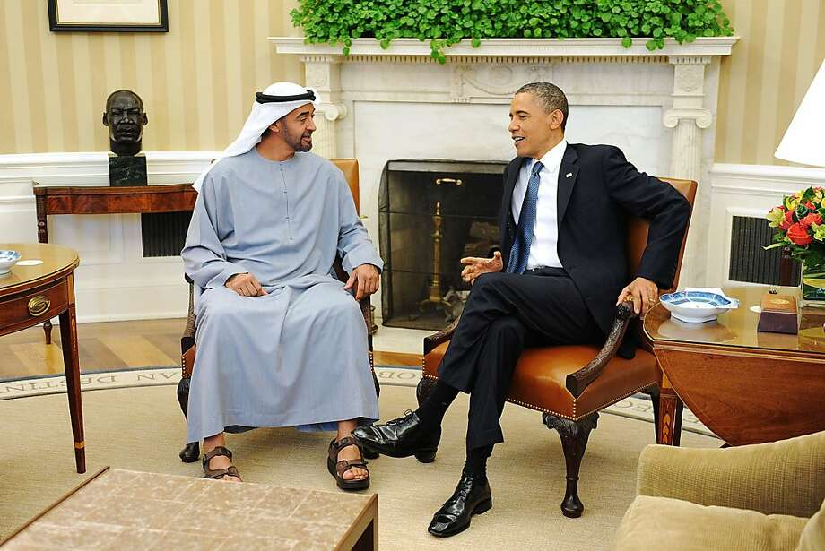 "U.S. President Barack Obama, right, speaks with the Crown Prince of Abu Dhabi, Sheikh Mohammed Bin Zayed Al Nahyan from the United Arab Emirates during a bilateral meeting at the Oval Office of the White House in Washington, D.C., U.S., on Tuesday, April 26, 2011. Obama urged congressional leaders to act quickly on his proposals to eliminate ""unwarranted"" tax breaks for the oil and gas industry and use the savings to fund clean energy programs. Photographer: Olivier Douliery/Pool via Bloomberg *** Local Caption *** Mohammed Bin Zayed Al Nahyan; Barack Obama Photo: Olivier Douliery, Via Bloomberg"
