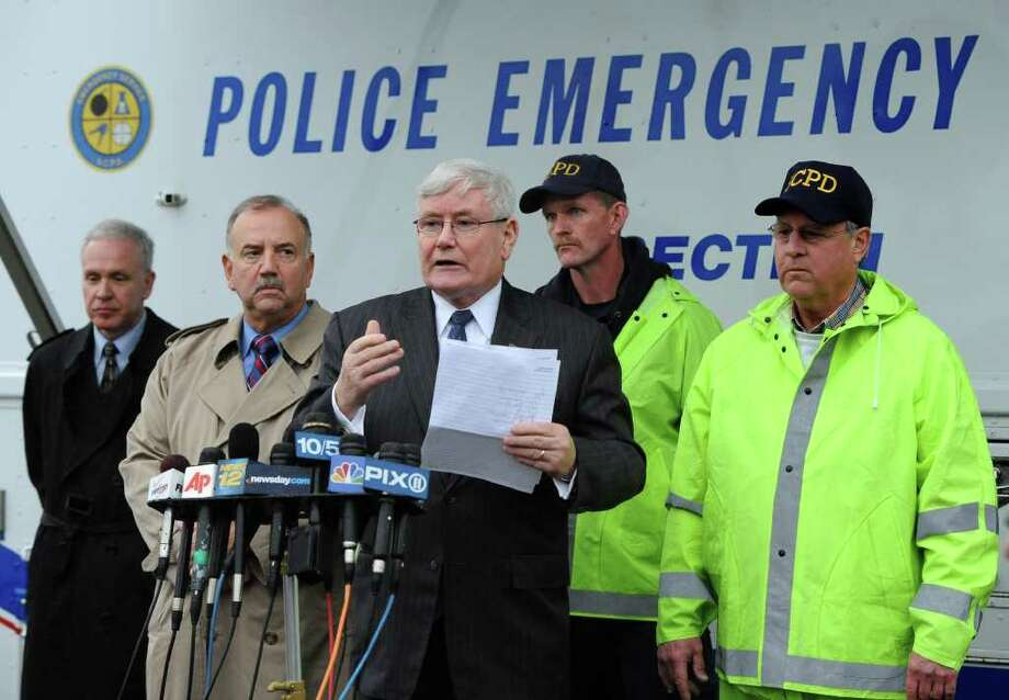 Suffolk County Police Commissioner Richard Dormer, center, updates the media during a news conference concerning personal belongings found believed to have belonged to a missing woman, Shannan Gilbert  on Wednesday, Dec. 7, 2011, in Oak Beach, N.Y. Gilbert of Jersey City, N.J., disappeared May 1, 2010. The search for the items took place not far from where the remains of 10 people have been found in the past year. With Dormer are, l-r: Suffolk County Deputy Chief Robert Cassagne, Chief Det. Dominic Varrone, Commanding Officer Special Patrol Bureau Stuart Cameron and Det. Lieut. Gerard Pelkofsky. (AP Photo/Kathy Kmonicek) Photo: Kathy Kmonicek