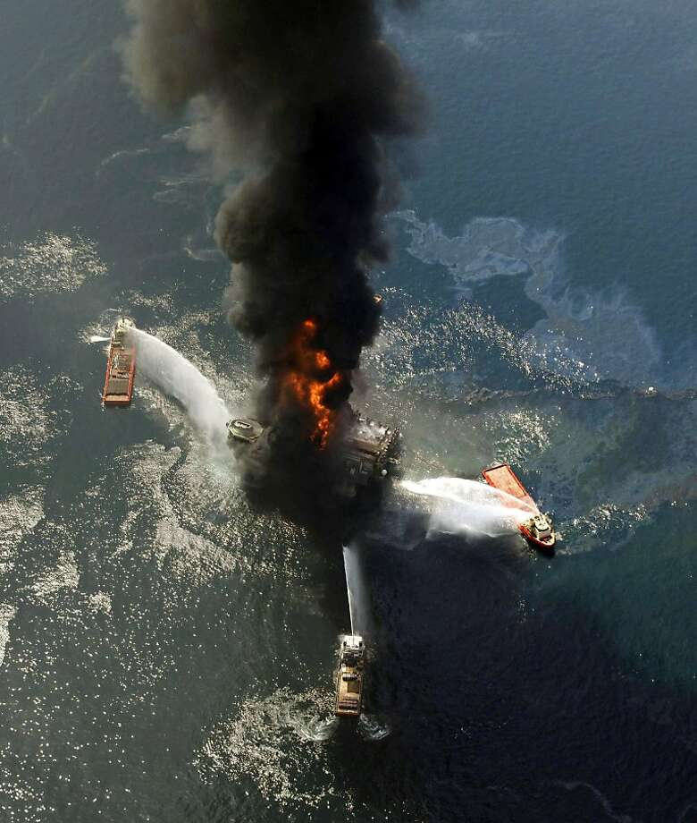 FILE - This April 21, 2010 file photo shows the Deepwater Horizon oil rig burning after an explosion in the Gulf of Mexico, off the southeast tip of Louisiana. The world's thirst for crude is leading explorers into ever deeper waters and ventures fraughtwith environmental and political peril, heralding an end to an easier era when companies could merely drill on land and wait for the oil _ and the profits _ to flow. From the Arctic to Cuba to the coast of Nigeria, the brave new world of oil drilling means that avoiding catastrophes like BP's Gulf spill is likely to become increasingly difficult and require global solutions and cooperation between countries that aren't used to working together. Photo: Gerald Herbert, AP
