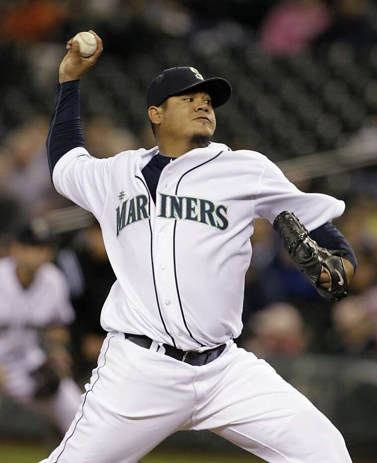 Seattle Mariners starting pitcher Felix Hernandez throws against the Oakland Athletics in the first inning of a major league baseball game Thursday, April 21, 2011, in Seattle. The Mariners won 1-0. Photo: Elaine Thompson, AP