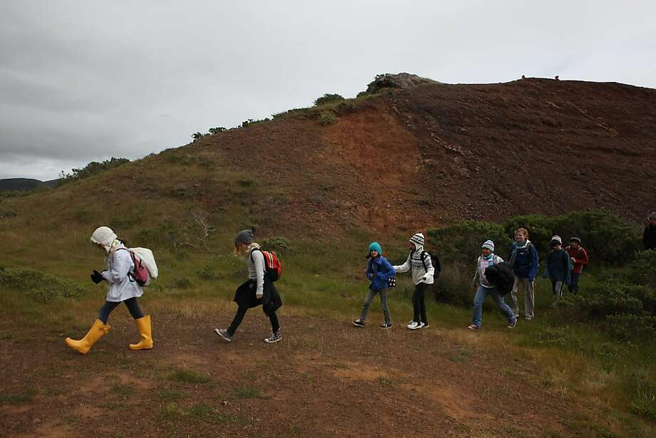 Fifth-graders from Berkeley's Cragmont Elementary walk the hills next to the Headlands Institute in Sausalito on Wednesday. Photo: Liz Hafalia, The Chronicle