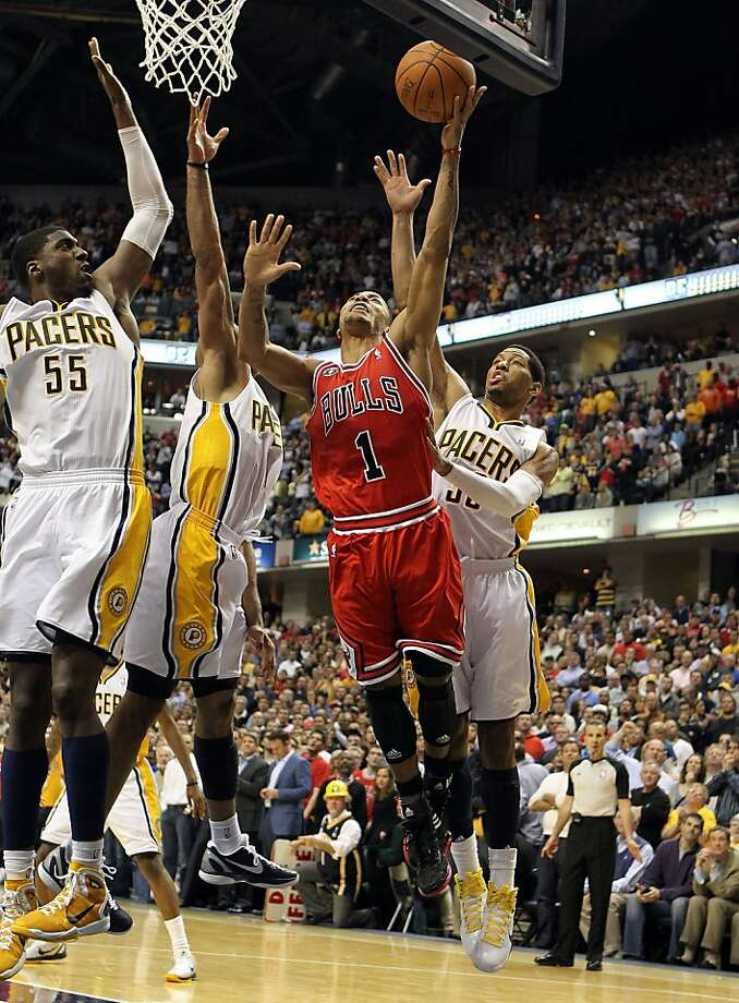 INDIANAPOLIS, IN - APRIL 21:  Derrick Rose #1 of the Chicago Bulls launches the game winning shot while defended by Roy Hibbert #55, Dahntay Jones #1 and Danny Granger #33 of the Indiana Pacers in Game three of the Eastern Conference Quarterfinals in the2011 NBA Playoffs on April 21, 2011  at Conseco Fieldhouse in Indianapolis, Indiana. The Bulls won 88-84.  NOTE TO USER: User expressly acknowledges and agrees that, by downloading and/or using this Photograph, User is consenting to the terms and conditions of the Getty Images License Agreement. Photo: Andy Lyons, Getty Images