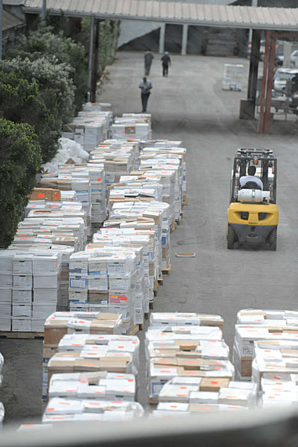 Palates of documents sit and are moved around outside of the Cow Palace in Daly City, Calif., Friday, March 4, 2011.
