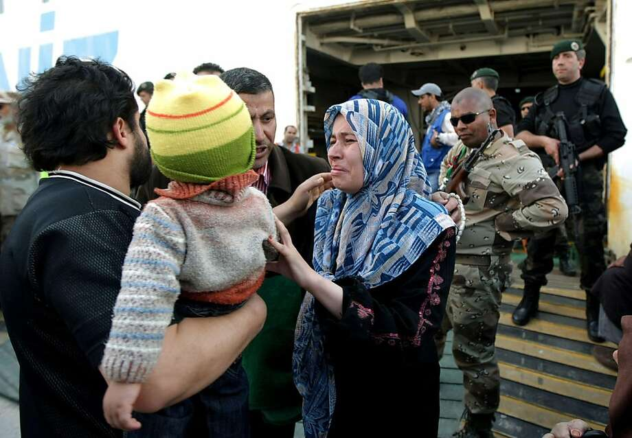 A Libyan woman evacuated from the besieged city of Misrata weeps as she disembarks from the Turkish ship Ankara upon arrival at Benghazi port on April 21, 2011. At least 1,400 civilians fled Misrata onboard Ankara, feeling vicious combat between rebels and forces loyal to Moamer Kadhafi. Photo: Marwan Naamani, AFP/Getty Images