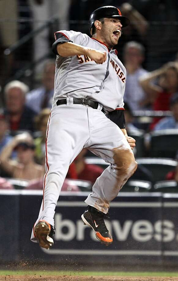 San Francisco Giants' Freddy Sanchez reacts after scoring the go-ahead run on a Buster Posey ground ball and an error by Atlanta Braves' Brooks Conrad in the ninth of Game 3 of baseball's National League Division Series, Sunday, Oct. 10, 2010, in Atlanta.San Francisco won 3-2. Photo: John Bazemore, AP