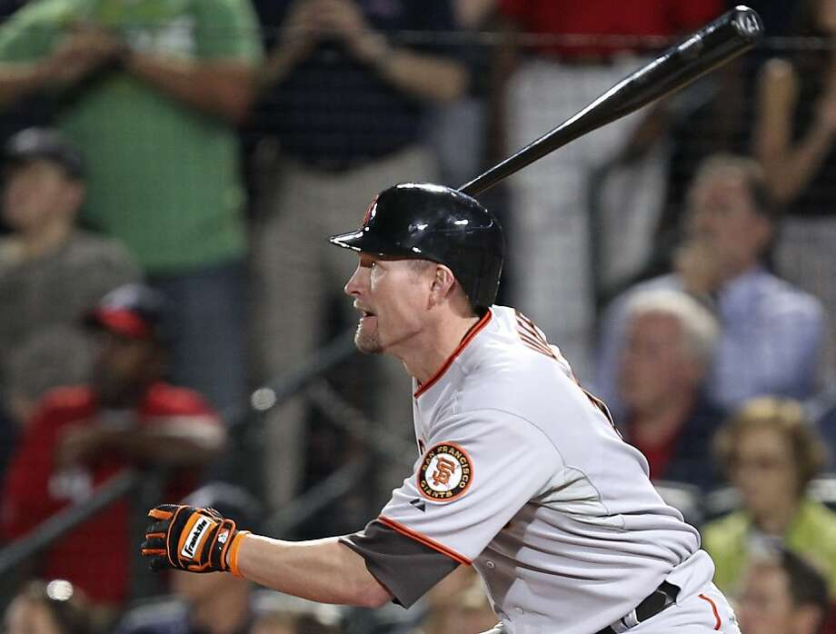San Francisco Giants' Aubrey Huff follows through with an RBI single to tie Game 3 of the National League Division Series against the Atlanta Braves in the ninth inning Sunday, Oct. 10, 2010, in Atlanta. San Francisco won 3-2 and leads the best-of-five series 2-1. Photo: John Bazemore, AP