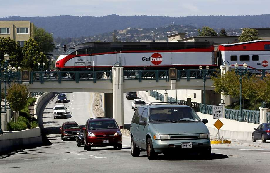 A CalTrain crosses Jefferson Avenue in Redwood City, Calif. on Wednesday April 29, 2009, as a battle is shaping up on the Peninsula over high-speed rail service through the Silicon Valley with residents and cities favoring a system that runs through a tunnel or along a sunken trench. Photo: Michael Macor, The Chronicle