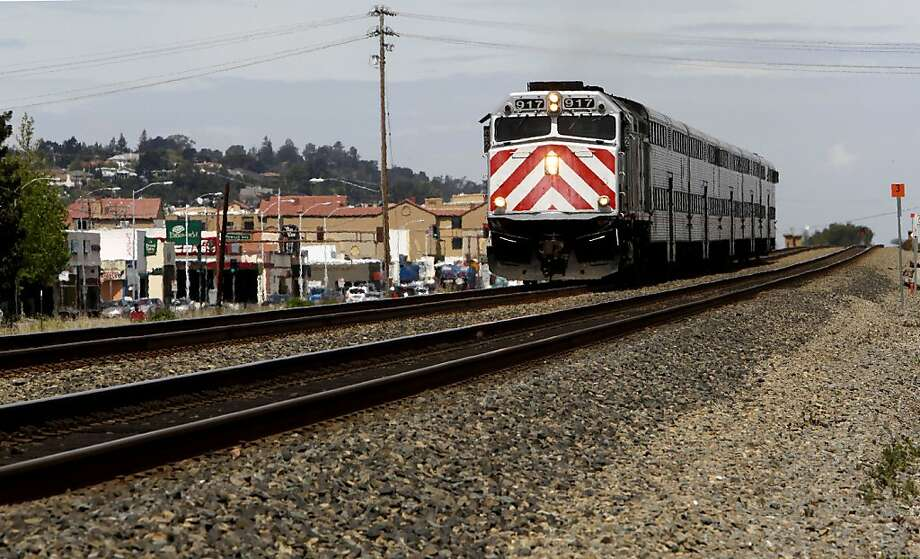 A CalTrain glides along an elevated section of track through San Carlos, Calif. on Wednesday April 29, 2009, as a battle is shaping up on the Peninsula over high-speed rail service through the Peninsula with residents and cities favoring a system that runs through a tunnel or along a sunken trench. Photo: Michael Macor, The Chronicle
