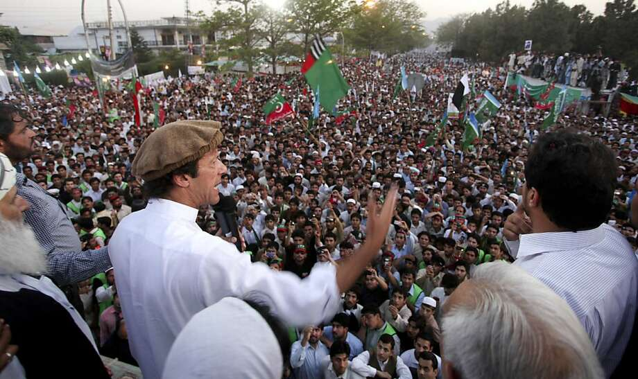 Pakistani cricket legend-turned politician Imran Khan, center wearing cap, addresses the crowd during a rally against the U.S. drone strikes in Pakistani tribal areas, Saturday, April 23, 2011,  in Peshawar, Pakistan.  Pakistan stopped NATO supplies fromtraveling to Afghanistan on Saturday as thousands of protesters rallied on the main road leading to the border, demanding U.S. Washington stop firing missiles against militants sheltering inside the country. Photo: Mohammad Sajjad, AP