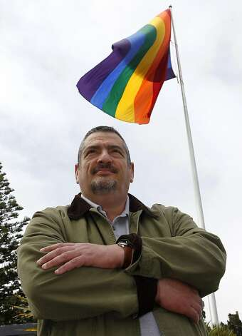 Michael Petrelis stands below the rainbow flag that flies at Market and Castro streets in San Francisco, Calif. on Saturday, April 23, 2011. Petrelis is urging community leaders to fly the stars and stripes on Harvey Milk Day but is meeting resistance to his idea. Photo: Paul Chinn, The Chronicle