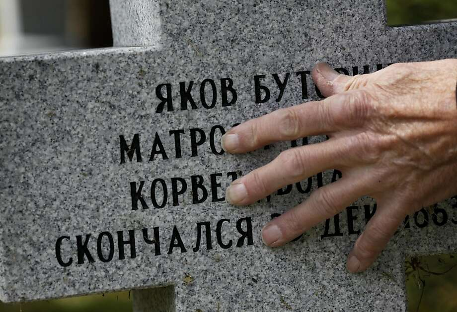 Kenneth Zadwick rubs the lettering indentations on the new granite gravestone of a Russian sailor Thursday April 14, 2011. Kenneth Zadwick helps care for the Mare Island Cemetery in Vallejo, Calif. as part of his role as head of the Mare Island Park Historical Foundation. Photo: Brant Ward, The Chronicle