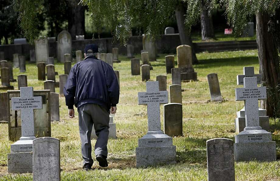 Kenneth Zadwick walks past the new gravestones of some eight Russian sailors in the Mare Island Cemetery Thursday April 14, 2011. Kenneth Zadwick helps care for the Mare Island Cemetery in Vallejo, Calif. as part of his role as head of the Mare Island Park Historical Foundation. Photo: Brant Ward, The Chronicle