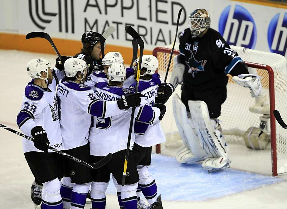 Los Angeles Kings left wing Kyle Clifford (13), in back, is congratulated by teammates after scoring past San Jose Sharks goalie Antti Niemi (31) during the first period in Game 5 of a first-round NHL Stanley Cup playoffs hockey series in San Jose, Calif., Saturday, April 23, 2011. Photo: Paul Sakuma, AP