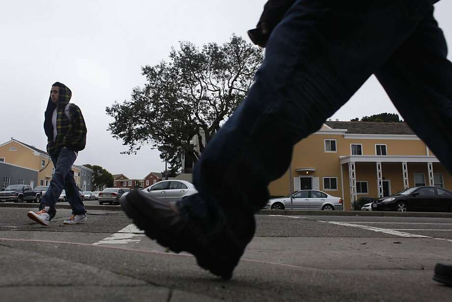 Pedestrians walk along Holloway Avenue near San Francisco State University, which is across from Parkmerced, on Monday, January 31, 2011 in San Francisco, Calif. Photo: Lea Suzuki, The Chronicle