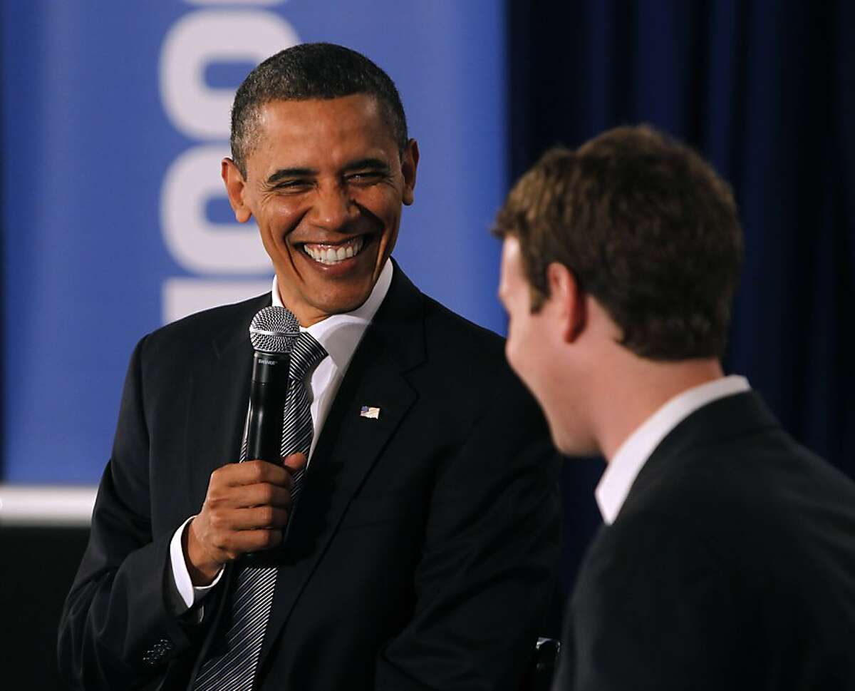 President Obama leads a town hall-style meeting, moderated by Facebook CEO Mark Zuckerberg (right) to discuss the economy and the national debt in Palo Alto, Calif. on Wednesday, April 20, 2011. Facebook hosted the gathering at its headquarters and made it available for the public to participate and ask questions on its website.