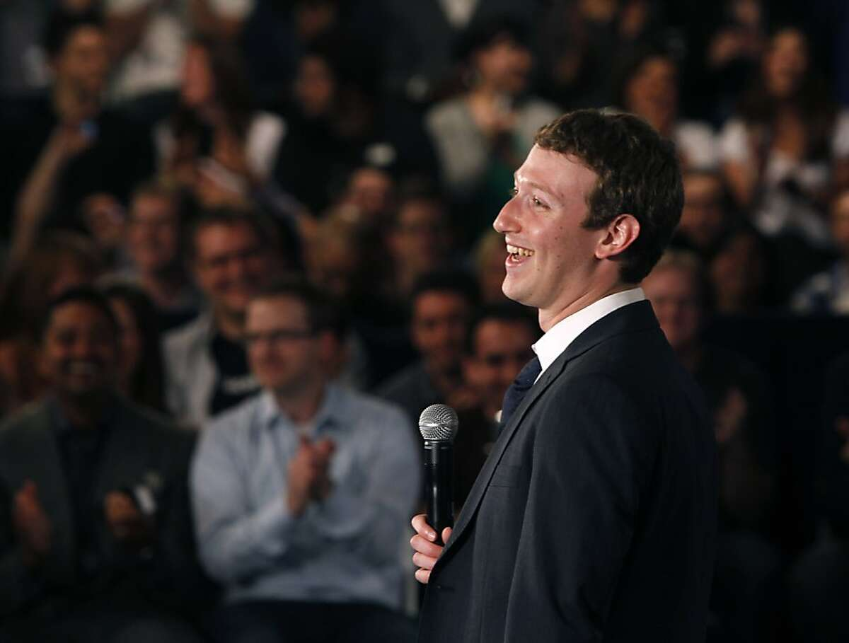 Facebook CEO Mark Zuckerberg introduces President Obama at a town hall-style meeting to discuss the economy and the national debt in Palo Alto, Calif. on Wednesday, April 20, 2011. Facebook hosted the gathering at its headquarters and made it available for the public to participate and ask questions on its website.