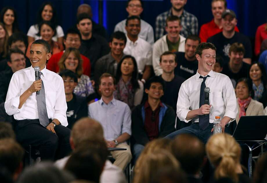 President Obama leads a town hall-style meeting, moderated by Facebook CEO Mark Zuckerberg (right) to discuss the economy and the national debt in Palo Alto, Calif. on Wednesday, April 20, 2011. Facebook hosted the gathering at its headquarters and made it available for the public to participate and ask questions on its website. Photo: Paul Chinn, The Chronicle