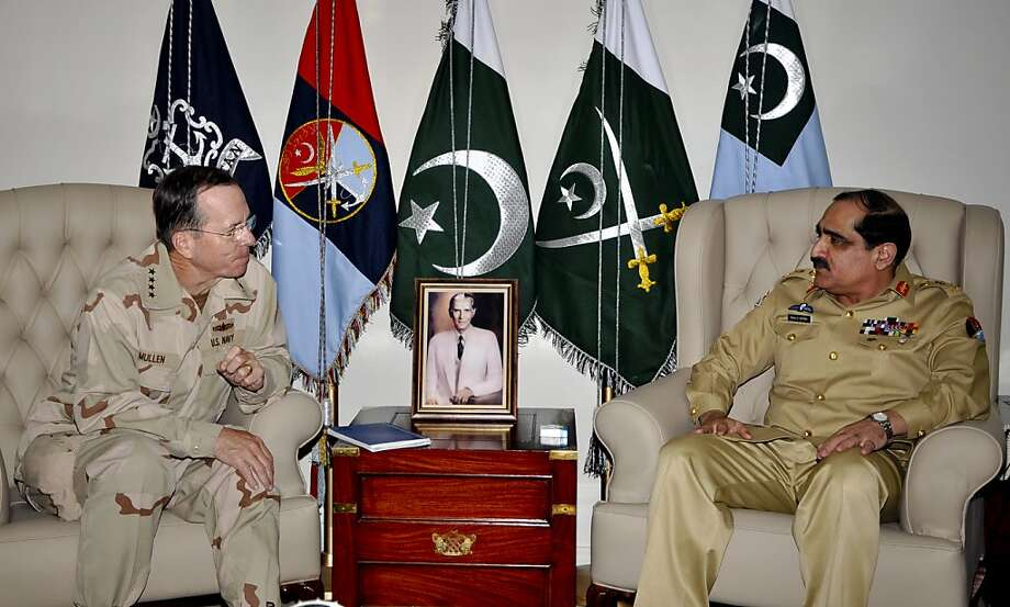 In this photo released by Inter Services Public Relations, U.S. Chairman of the Joint Chiefs of Staff Adm. Mike Mullen, left, listens to Pakistan's Chairman Joint Chiefs of Staff Committee  General Khalid Shameem Wynne during a meeting in Rawalpindi, Pakistan on Wednesday, April 20, 2011. Mullen is visiting Pakistan at a time of tensions over America's role in the region. Photo: AP