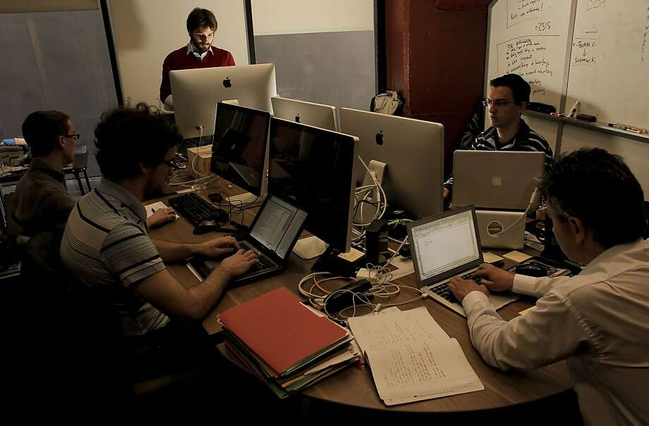 Co-founder and CEO Solomon Hykes, (top) of DotCloud at his South of Market Street offices, in San Francisco, Ca. on Wednesday April 20, 2011. Co-workers are (left to right) Luis Opter, (engineer), Jerome Betazzoni, (engineer), Samuel Alba, (engineer) and Eric Bardin, (CFO).  Tech startups are building companies to help tech startups. Many different programming languages and cloud computing tools have been developed in recent years and now companies are emerging to try to organize the chaos and obviously make money. DotCloud is raising $10 million in venture funding. Photo: Michael Macor, The Chronicle