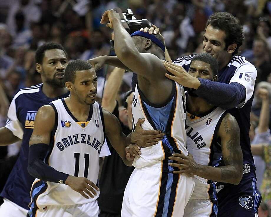 Memphis Grizzlies forward Zach Randolph, center, is mobbed by teammates after hitting a 3-point-shot against the San Antonio Spurs in the final seconds of the second half of Game 3 of a first-round NBA basketball series on Saturday, April 23, 2011, in Memphis, Tenn. The Grizzlies won 91-88 to take a 2-1 lead in the series. Photo: Mark Humphrey, AP