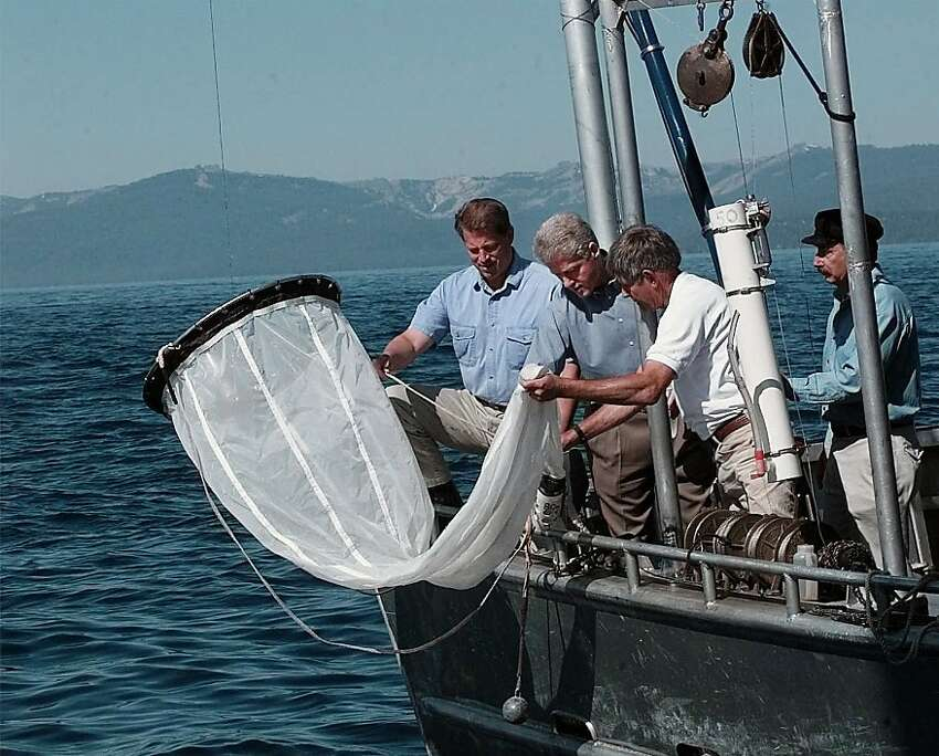 President Clinton and Vice President Al Gore help pull up a water sample from Lake Tahoe while on board the John LeConte research boat from University of California at Davis, Saturday, July 26, 1997 near Incline Village, Nev. Dr. Charles Goldman,wearing hat, and Dr. John Reuter, white shirt are at right. The President then signed an executive order on the preservation of Lake Tahoe.(AP Photo/Ruth Fremson)