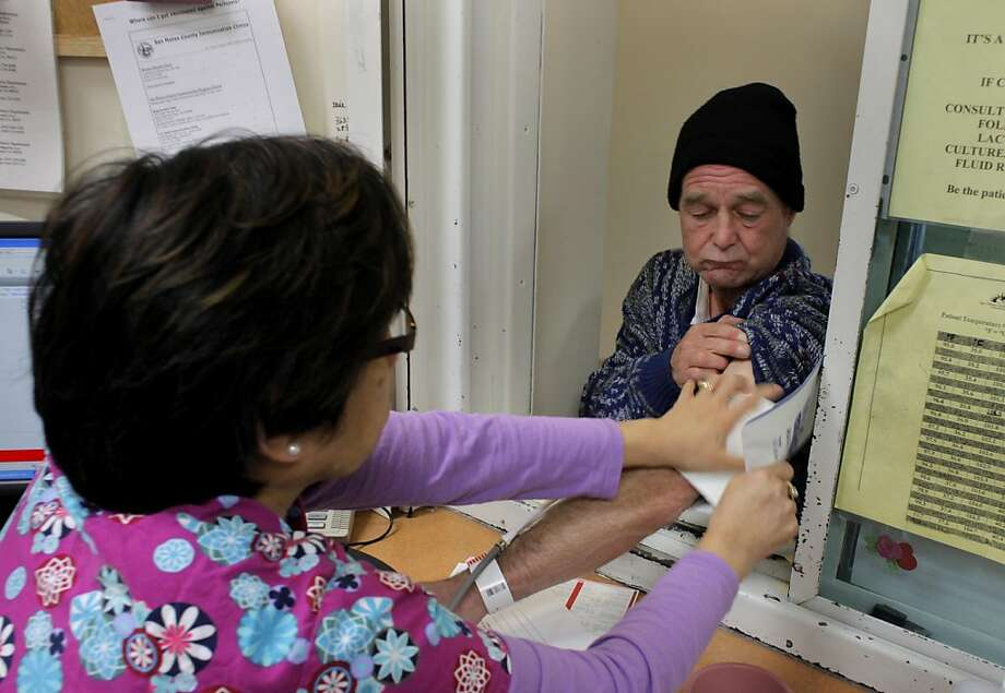 Registered nurse Lourdes Tolentino screens patient Brian Rosborough for sepsis, Monday April 18, 2011, at the San Mateo Medical Center in San Mateo, Calif. The  Center is one of nine hospitals in the Bay Area where the UCSF nursing project is used  to reduce the mortality rate from sepsis. They check all patients who come into the emergency department for sepsis. Photo: Lacy Atkins, The Chronicle