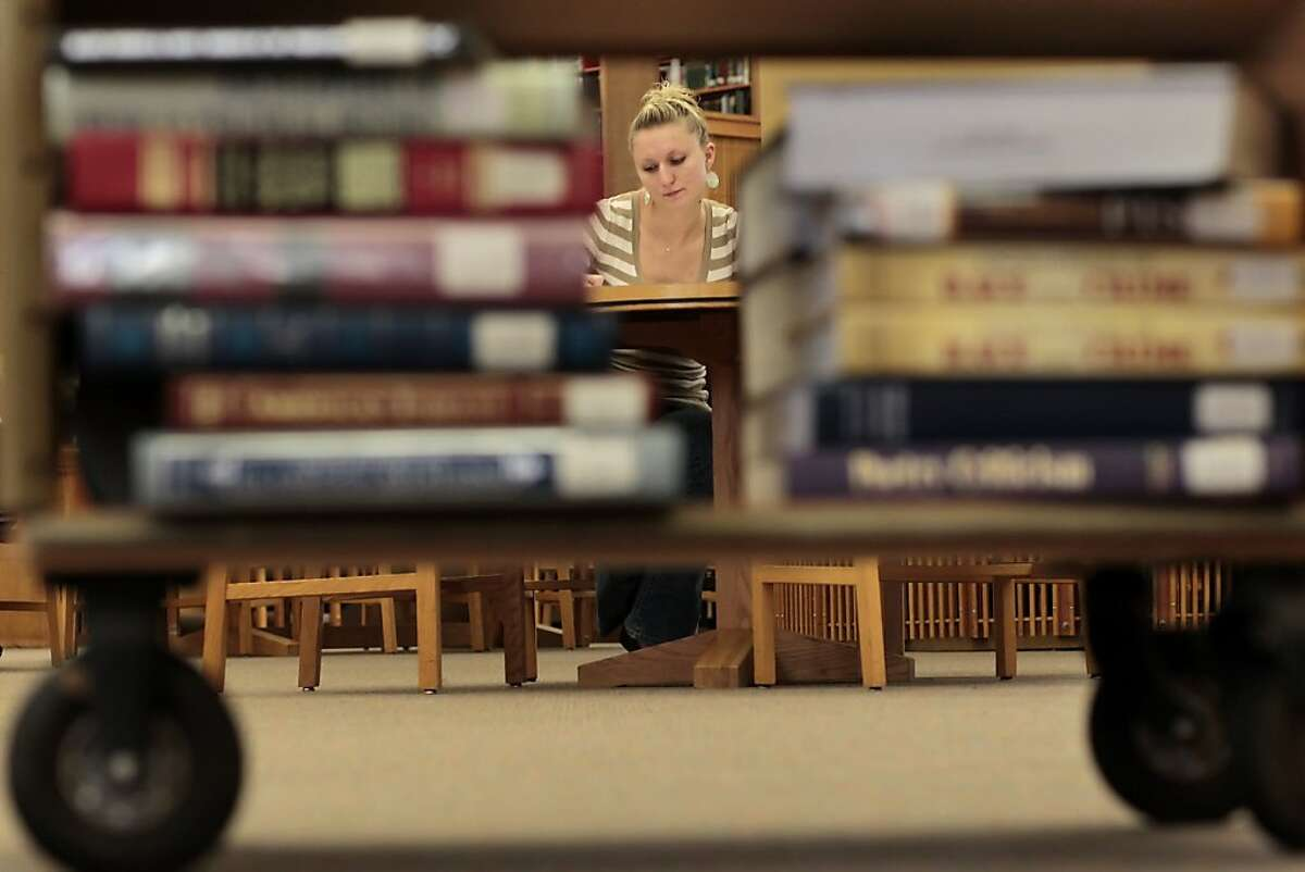 Ashley Ward, a senior at Notre Dame de Namur, studies at the library, Tuesday April 19, 2011, in Belmont, Calif. Ward transfered from San Francisco State after not getting classes declaring a major.