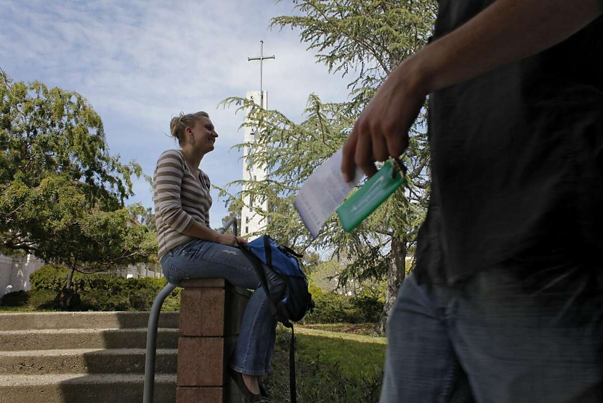 Ashley Ward, a senior at Notre Dame de Namur, sits outside the library ,Tuesday April 19, 2011, in Belmont, Calif. Ward transfered from San Francisco State after not getting classes declaring a major.