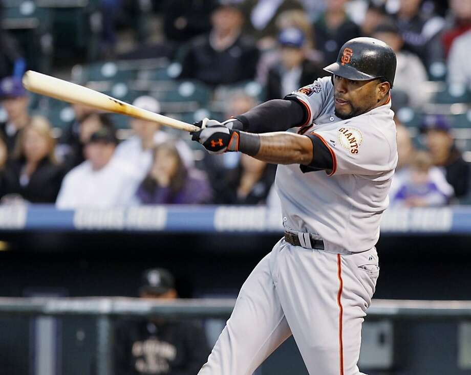 San Francisco Giants Pablo Sandoval follows through on a three-run home run in the first inning of a major league baseball game against the Colorado Rockies at Coors Field in Denver on Tuesday, April 19, 2011. Photo: Ed Andrieski, AP
