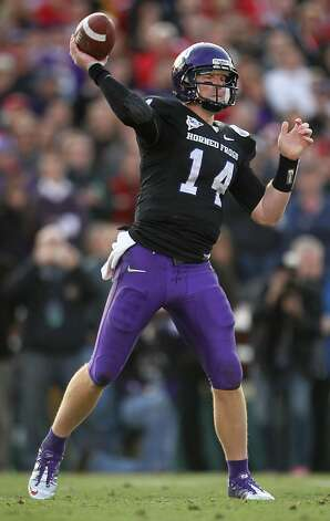 PASADENA, CA - JANUARY 01:  Quarterback Andy Dalton #14 of the TCU Horned Frogs throws a pass against the Wisconsin Badgers in the 97th Rose Bowl game on January 1, 2011 in Pasadena, California.  (Photo by Jeff Gross/Getty Images) Photo: Jeff Gross, Getty Images