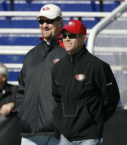 49ers scout Joel Patten, left, and GM Trent Baalke check out the action during the North's Senior Bowl practice Wednesday January 26, 2011 at Ladd-Peebles Stadium in Mobile, AL. Photo: Chip English, Special To The Chronicle
