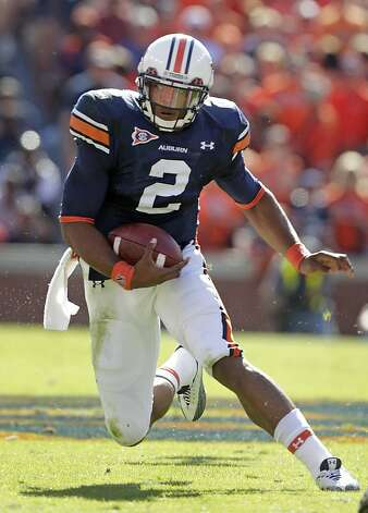 FILE - In this Oct. 16, 2010 file photo, Auburn quarterback Cam Newton runs against Arkansas during the first half of an NCAA college football game in Auburn, Ala. Newton is a top prospect in the upcoming NFL Draft. Photo: Dave Martin, Associated Press 2010