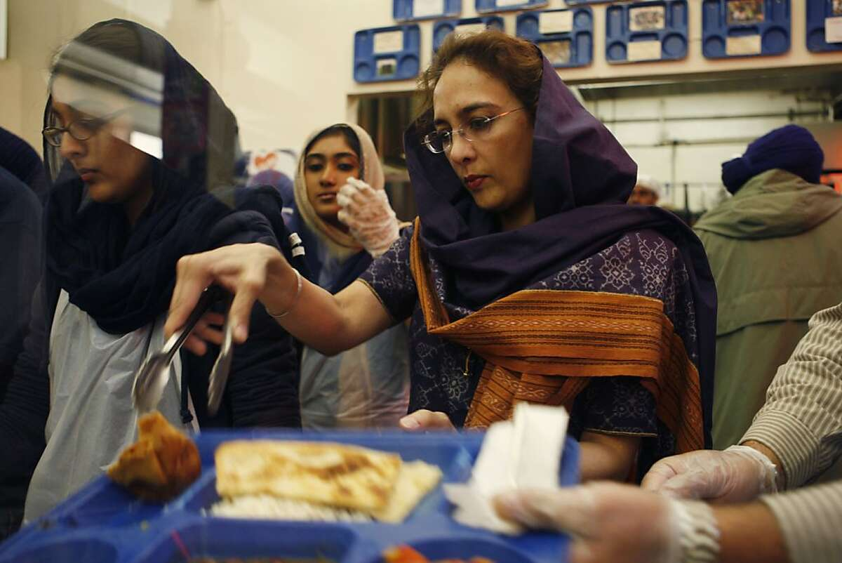 Harmeet Dhillon, San Francisco County chair of the Republican Party helps out at a United Sikhs organized free lunch at Glide Memorial Church in San Francisco Calif, on Saturday, April 10, 2011.