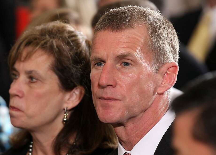 WASHINGTON - APRIL 12:  Retired U.S. Army General and former Commander of International Security Assistance Force (ISAF) and Commander of U.S. Forces Afghanistan (USFOR-A) Stanley McChrystal (R) and his wife Annie listen during an event to launch JoiningForces, a national initiative to support and honor American's service members and their families, April 12, 2011 in the East Room of the White House in Washington, DC. The first lady and Vice President Joseph Biden's wife Jill Biden will start a two-day national tour to visit examples of communities, businesses and non-profits organizations working to support military families. Photo: Alex Wong, Getty Images