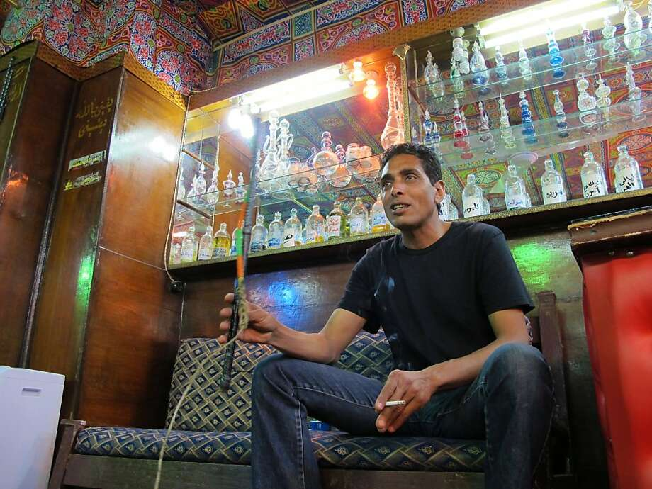Abrahim Fikhry, 41, who runs a shop that sells aromatic essences near the Giza pyramids, said the revolution in Egypt has killed his business. Illustrates EGYPT-TOURISM (category i), by Fredrick Kunkle (c) 2011, The Washington Post. Moved Monday, April 18, 2011. (MUST CREDIT: Washington Post photo by Fredrick Kunkle.) Photo: Post, The Washington Post