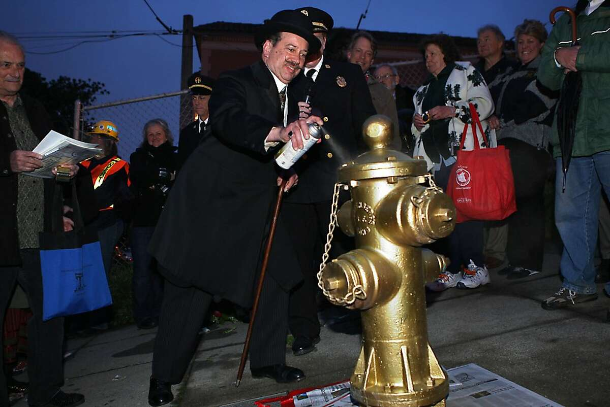 Bob Hillman, historian for Ghirardelli, spraypaints the fire hydrant on Church at 20th streets in San Francisco, Calif., to commemorate the 105th anniversary of the San Francisco earthquake on Monday, April 18, 2011.