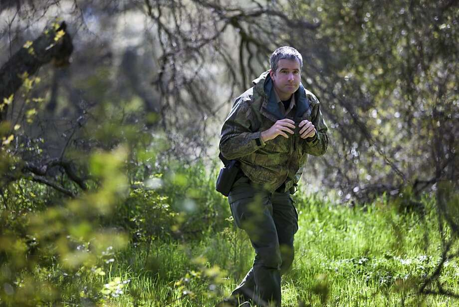 Patrick Foy, a warden with the Department of Fish and Game in Sacramento patrols along the American River Wednesday,  March 30, 2011. He generally is on the look out for poachers and marijuana growers. Photo: Deanne Fitzmaurice, Special To The Chronicle