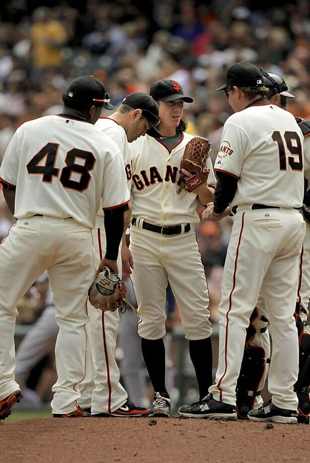 Giants starting pitcher Tim Lincecum and teammates meet on the mound in the fourth inning against the Atlanta Braves at AT&T Park in San Francisco on Saturday. Photo: Michael Macor, The Chronicle